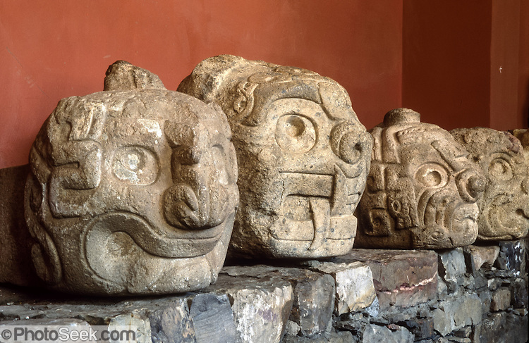 Carved stone jaguar heads, Chavin de Huantar, Andes Mountains, Peru.